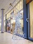 wicker angel in commercial center